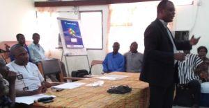 The District Assembly Procurement Officer addressing community representatives, Volta Region