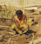 Woman farmer planting tree seedlings