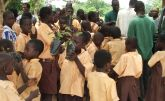 Children carrying their tree seedlings for watering