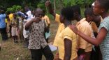 Mr. Manu teaching the children how to monitor the water quality at Lake Bosumtwe